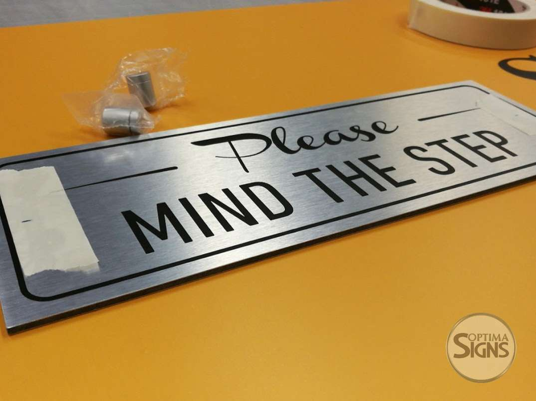 Please Mind the step brushed aluminium sign