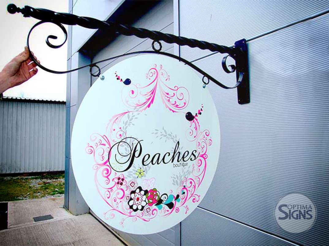 peaches boutique projecting sign